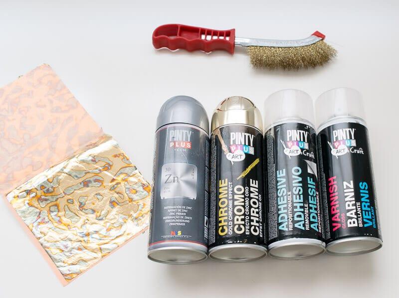 materiales para decorar una máquina de coser con pan de oro